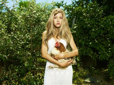 Beautiful woman with a pet - Chicken