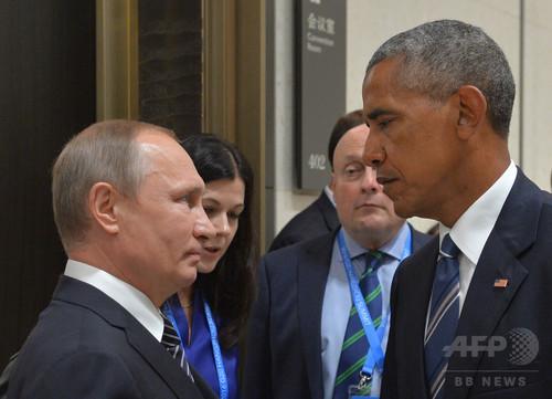 20か国・地域(G20)首脳会議開催中の中国・杭州で会談した米国のバラク・オバマ大統領(右)とロシアのウラジーミル・プーチン大統領