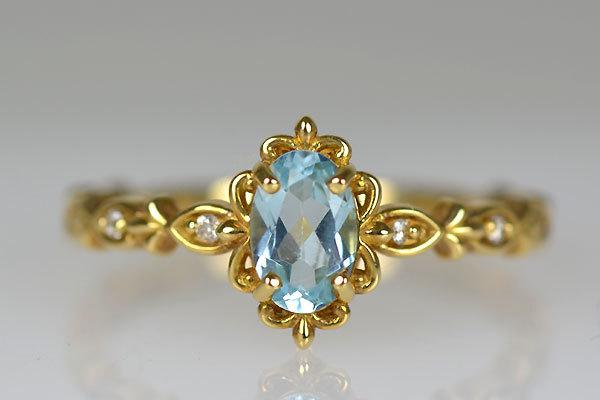 K18YG製イエローゴールドブルートパーズ・ダイアモンドリング指輪