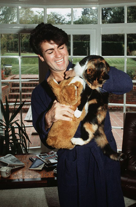 George-Michael-poses-at-home-with-his-cat-after-losing-his-voice-and-being-forced-to-cancel-a-number-of-live-shows-in-1980