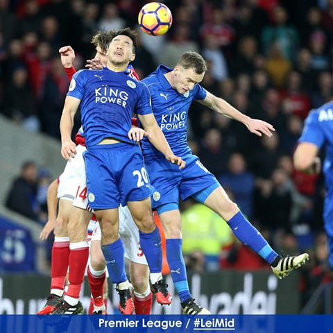 Andy King and Shinji Okazaki challenge for the ball with Middlesbroughs Marten De Roon