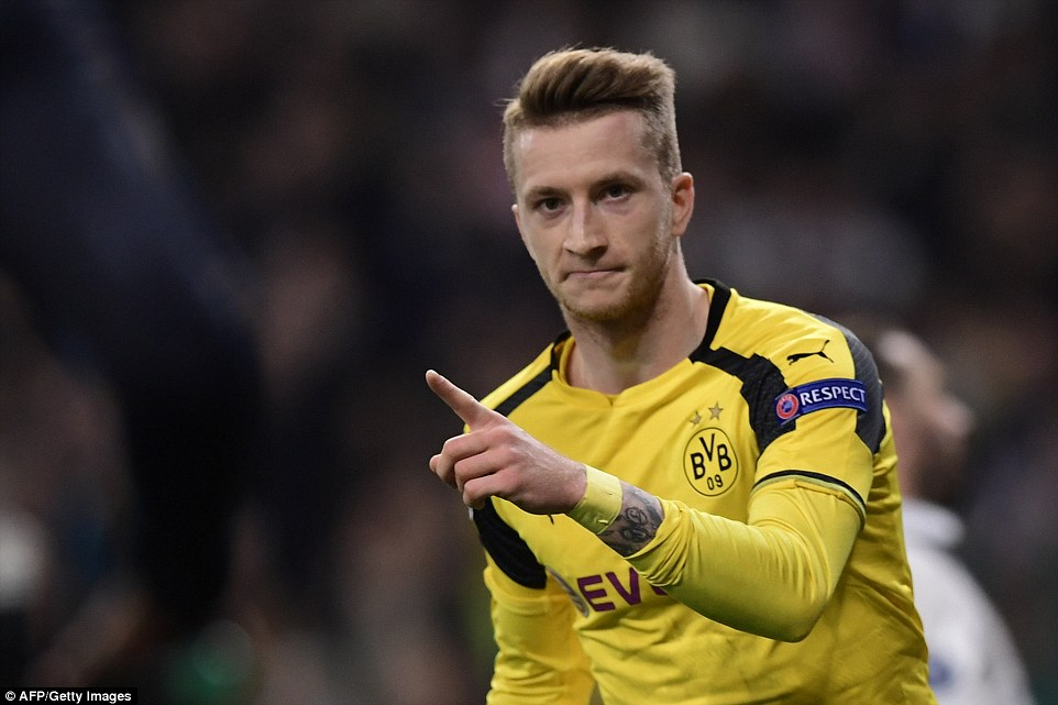 Reus points in celebration after rescuing a draw, and top spot, for Borussia Dortmund against Real Madrid