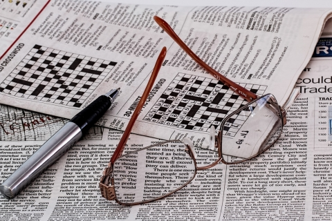 eyeglasses-and-ballpoint-pen-on-newspaper.jpg